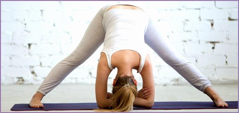 woman in wide legged forward bend yoga pose
