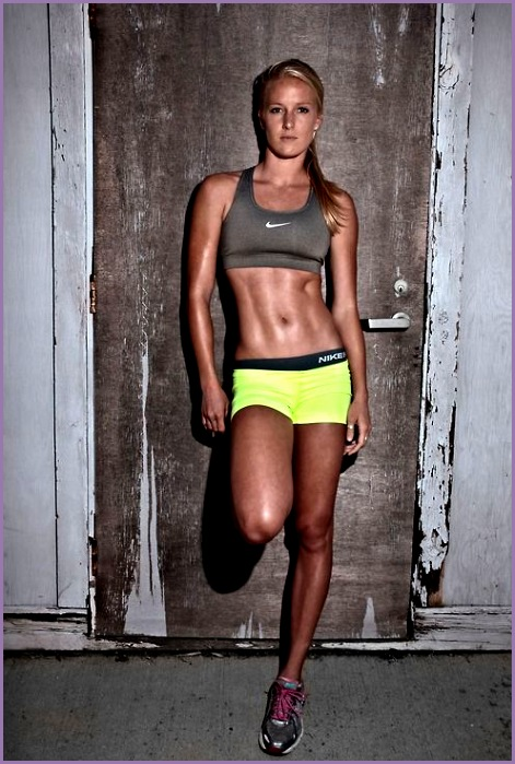 Attitude pose Spandex shorts sports bra and hair pulled back Simple shot to