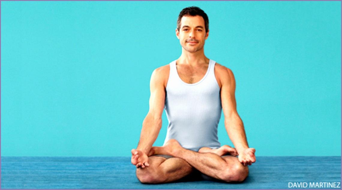 man doing yoga in padmasana lotus pose