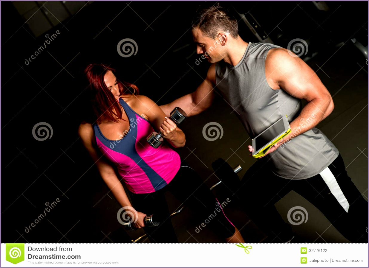 stock photography woman exercising instructor using digital tablet young women fitness workout men coach image