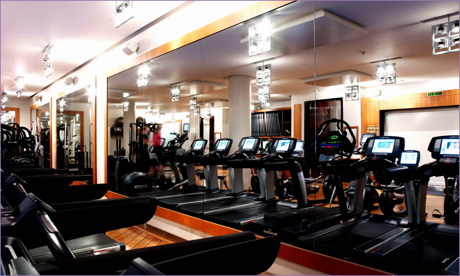 fresh modern fitness center room with great design of the room make it seems so modern and fresh by appying blue floor can add the fresh and natural atmosphere inside the modern fitness center room