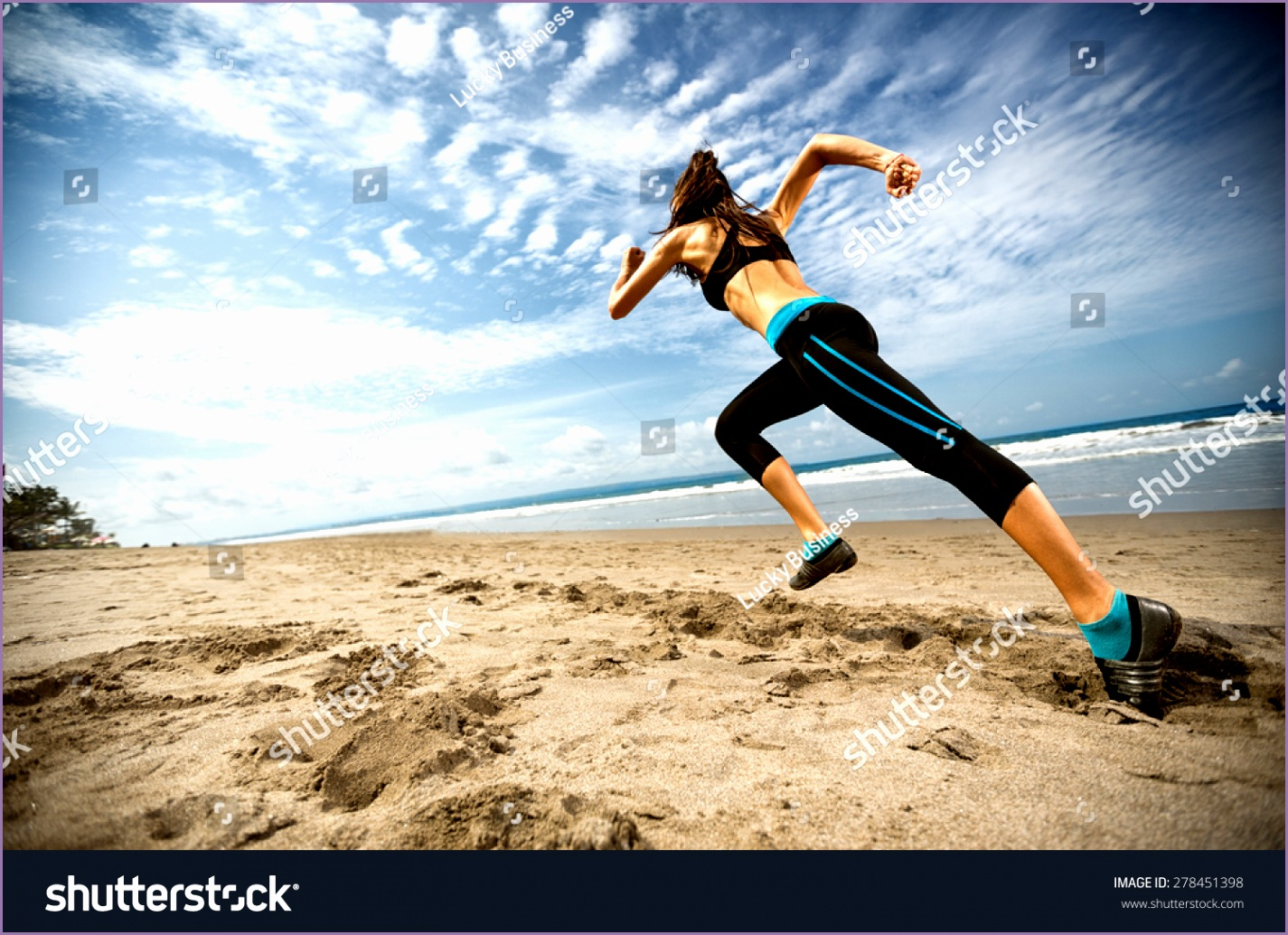 stock photo running woman female runner jogging during outdoor workout on beach fitness model outdoors