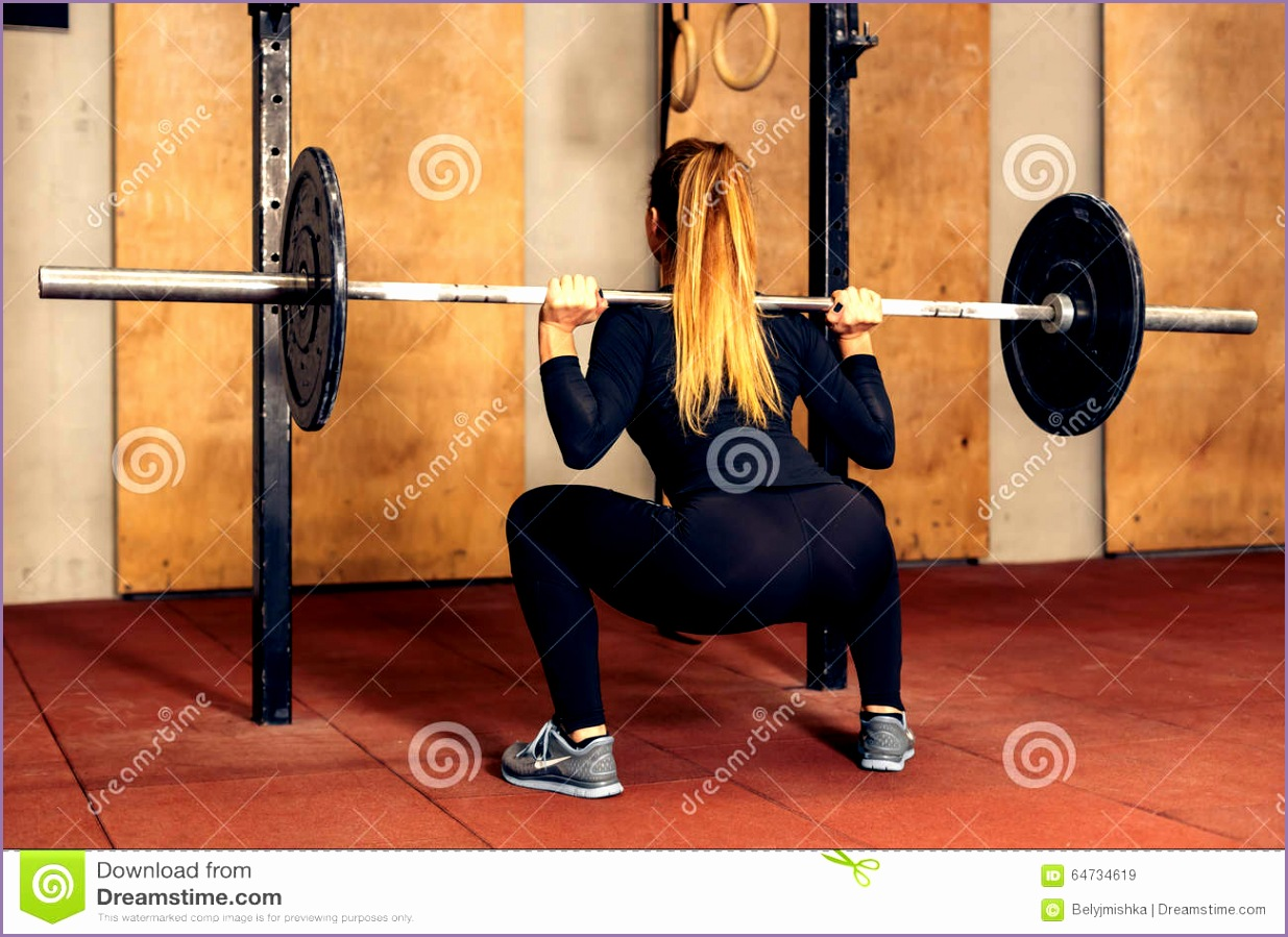 stock photo back view girl doing heavy squat barbell young adult duty gym woman perfect abs exercises fitness image