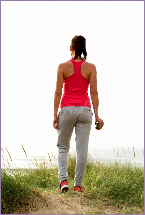stock photo fitness female athlete looking sea back view beach sporty woman towards ocean motivation exercising workout image